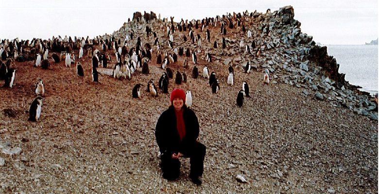 Sandi Davison and Chinstrap Penguins, Half Moon Island, Antarctica